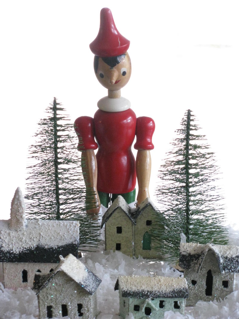Pinocchio overlooks snowy village