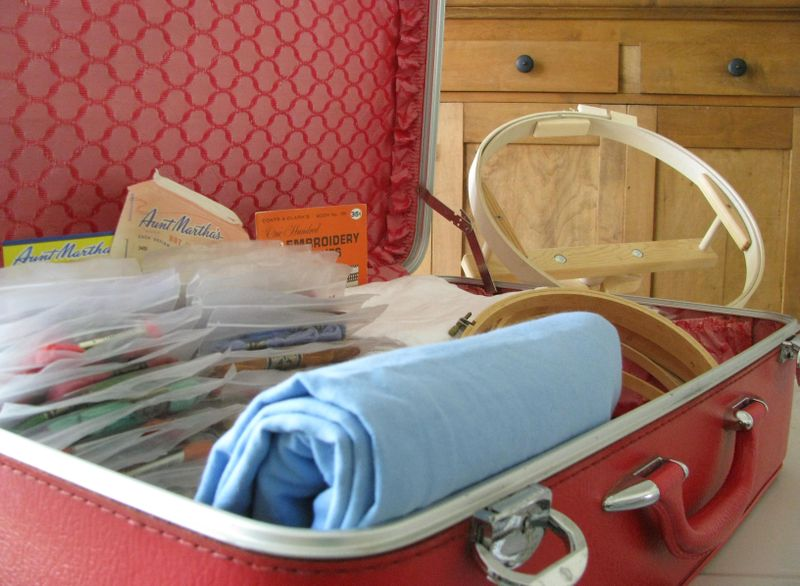 Suitcase with embroidery supplies