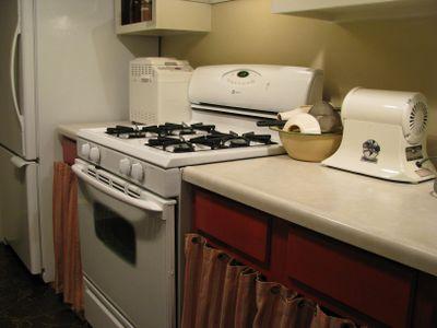 Kitchen cabinets hollyhock red