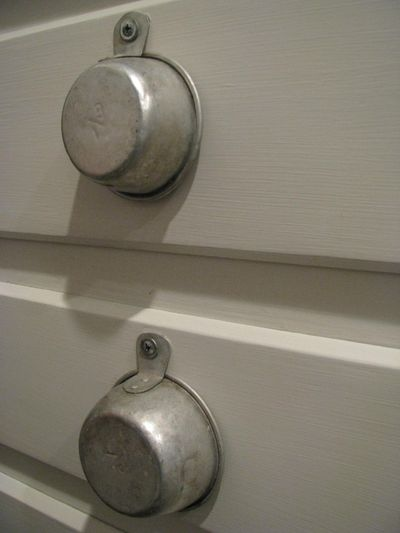 Measuring cup drawer pulls