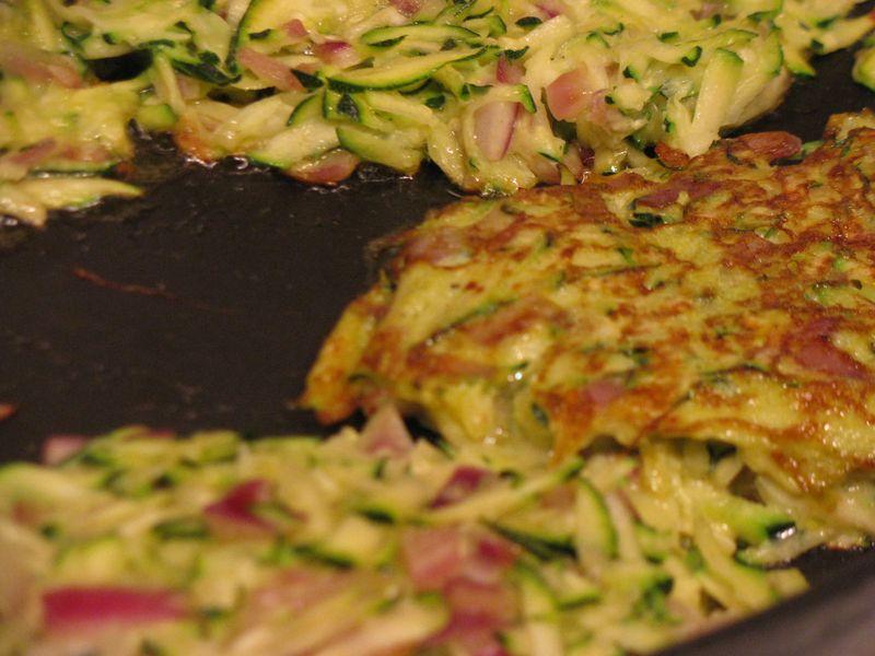 Zucchini patties browning