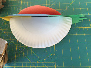 Attaching bird to paper plate